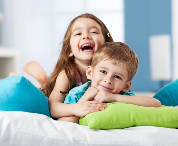 young children smiling & playing on the floor I children's sedation dentistry in 62526