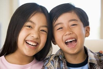 Young siblings smiling l dentist decatur il