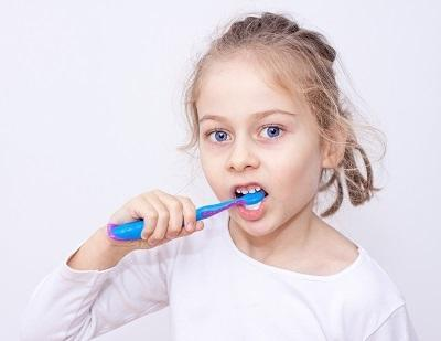 young girl brushing teeth I pediatric dentist in decatur il