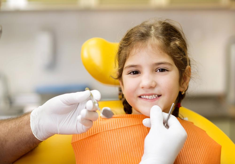 Young girl sitting in dental chair | decatur il dentist