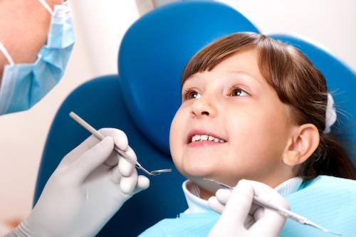 Girl in dental exam chair | Dentist in Decatur, IL