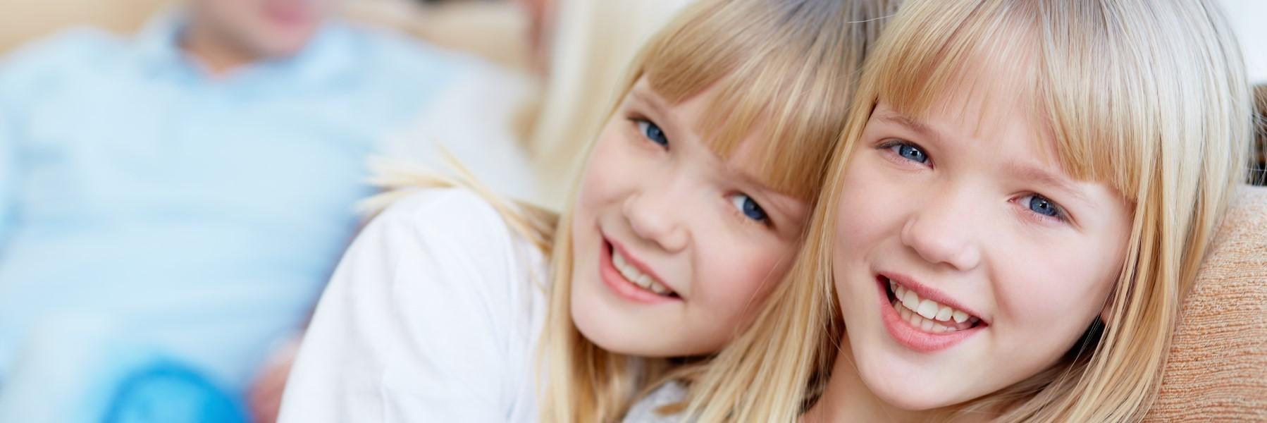 Two young girls smiling l Orthodontics Decatur IL