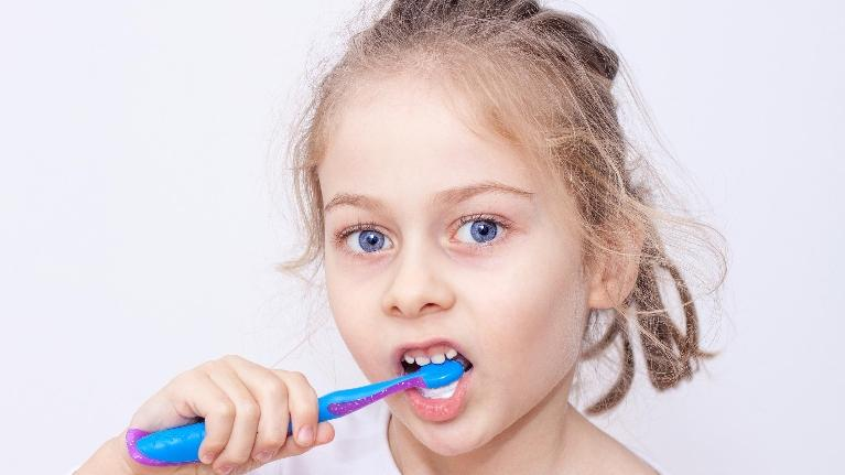 child brushing teeth | pediatric dentist decatur il