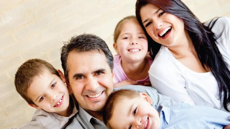 family of five smiling l dentist decatur il