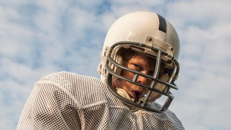 kid with football helmet | dental emergencies