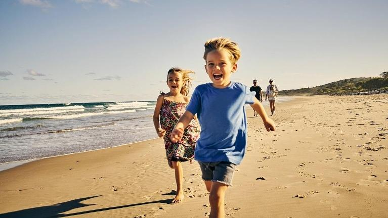 young children running on beach l orthodontics mt zion il